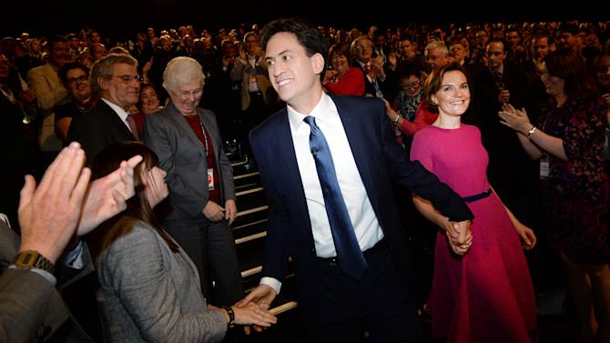 Britain's opposition Labour Party leader Ed Miliband and his wife Justine Thornton leave following his speech at the Labour Party's annual conference in Manchester