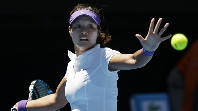 China's Li Na hits a forehand return to Russia's Maria Sharapova during their semifinal match at the Australian Open tennis championship in Melbourne, Australia, Thursday, Jan. 24, 2013. (AP Photo/Andy Wong)
