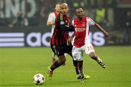 AC Milan's De Jong challenges and Ajax Amsterdam's Serero during their Champions League soccer match in Milan