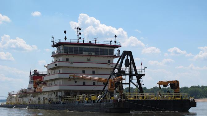 The 350-foot U.S. Army Corps of Engineers' Dredge Hurley works to clear a navigation channel on the Mississippi River on Monday, Aug. 20, 2012 near Memphis, Tenn. (AP Photo/Adrian Sainz)
