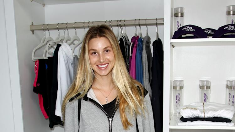 IMAGE DISTRIBUTED FOR AURACYCLE - Whitney Port poses for a photo before a give back ride at AuraCycle, in Los Angeles, Saturday, June 15, 2013 where she cycled with her family and friends in honor of her father that passed away in March from cancer. 100 percent of proceeds from the class went to the Uro Onocology Research Program Fund at Cedars-Sinai Medical Center. (Photo by Matt Sayles/Invision for AuraCycle/AP Images)