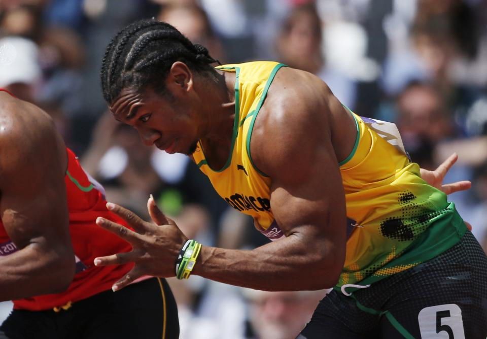 Jamaica's Yohan Blake competes in a men's 100-meter heat during the athletics in the Olympic Stadium at the 2012 Summer Olympics, London, Saturday, Aug. 4, 2012. (AP Photo/Matt Dunham)