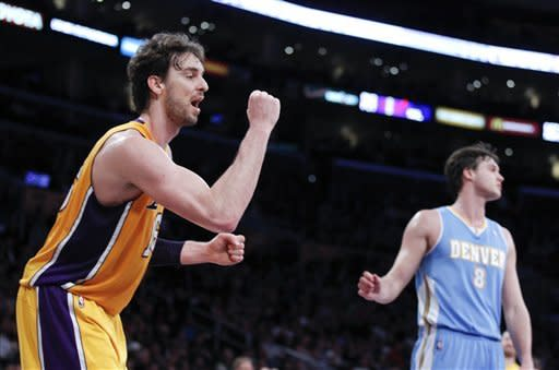 Lakers hold off Nuggets, clinch playoff berth