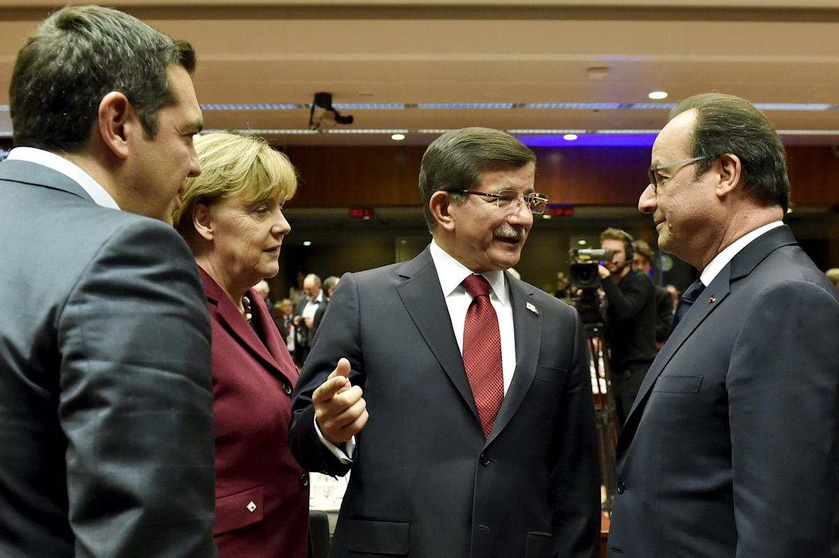 Greece's PM Tsipras, German Chancellor Merkel and Turkish PM Davutoglu talk to French President Hollande during an EU-Turkey summit in Brussels