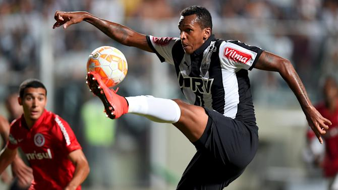 Jo of Atletico Mineiro controls the ball against Internacional during their Copa Libertadores soccer match in Belo Horizonte