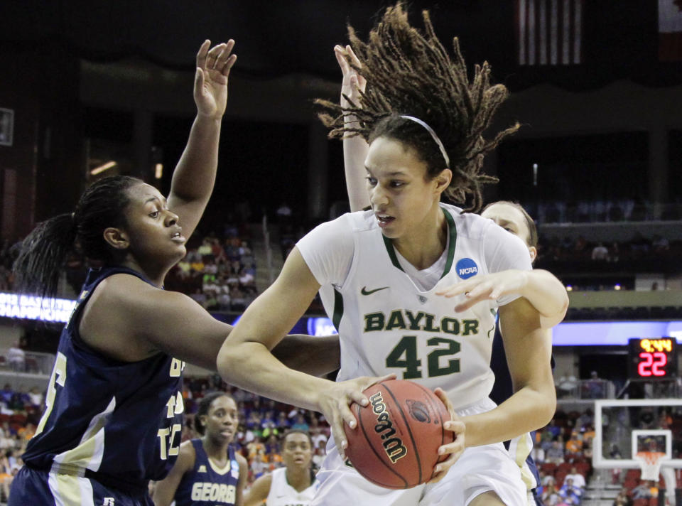 Baylor's Brittney Griner, center, is double teamed by Georgia Tech's' Sasha Goodlett, left, and Sarah Hartwell, in the first half of an NCAA women's tournament regional semifinal college basketball game in Des Moines, Iowa, Saturday, March 24, 2012. (AP Photo/Nati Harnik)