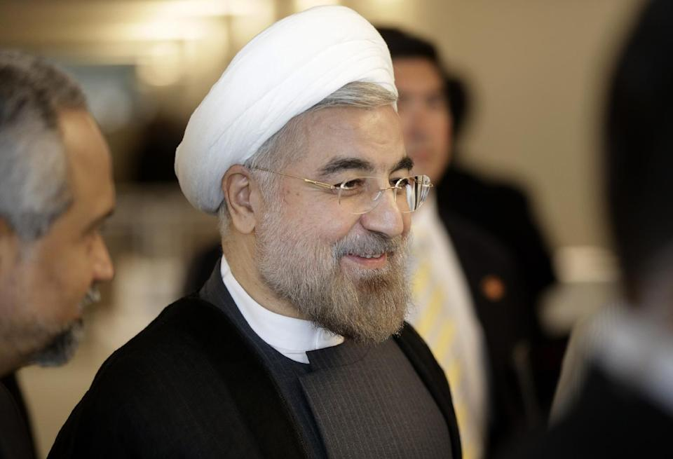 Iranian President Hassan Rouhani walks through the hallway during the 68th session of the General Assembly at United Nations headquarters, Thursday, Sept. 26, 2013. (AP Photo/Seth Wenig)