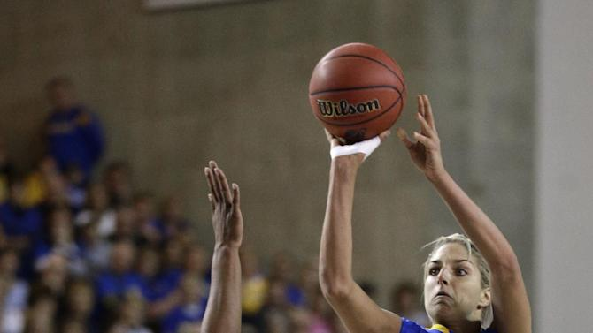 Delaware guard/forward Elena Delle Donne, right, shoots over North Carolina forward Xylina McDaniel during the second half of a second-round game in the women's NCAA college basketball tournament in Newark, Del., Tuesday, March 26, 2013. Delle Donne contributed a game-high 33 points to Delaware's 78-69 win. (AP Photo/Patrick Semansky)