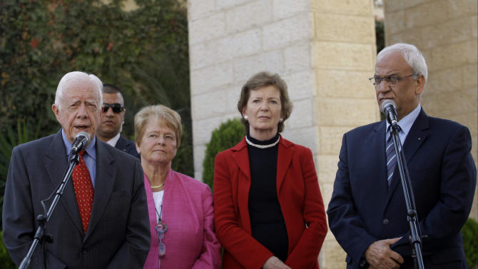 The Elders member former US President Jimmy Carter, left, and chief Palestinian negotiator Saeb Erekat, right, speak to the media with Mary Robinson, former United Nations High Commissioner for Human Rights, second right,  and Gro Harlem Brundtland, Norway's first woman Prime Minister, third right, following their meeting with Palestinian President Mahmoud Abbas in the West Bank city of Ramallah, Monday, Oct. 22, 2012. The Elders are visiting the region and holding meetings with Israeli and Palestinian leaders. (AP Photo/Nasser Shiyoukhi)