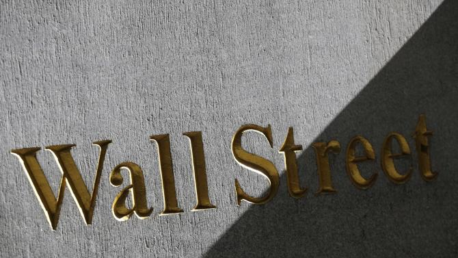 FILE - This March 4, 2013 photo shows a sign for Wall Street on the side of building near the New York Stock Exchange, in New York. Stocks rose Tuesday, May 27, 2014, after the government reported that orders for big-ticket items rose unexpectedly last month. Hillshire Brands jumped after poultry producer Pilgrim's Pride offered to buy the meat producer. (AP Photo/Mark Lennihan, File)