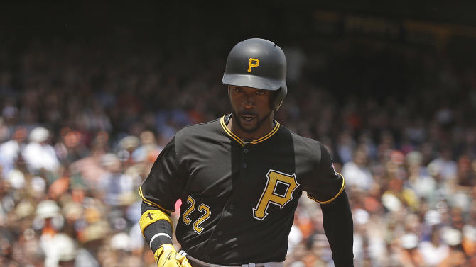 Pittsburgh Pirates' Andrew McCutchen comes into to score the Pirates' first run against the San Francisco Giants in the fourth inning of a baseball game Wednesday, June 3, 2015, in San Francisco. McCutchen scored when Jose Tabata singled to center field. (AP Photo/Eric Risberg)