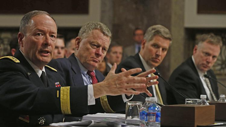 From left, Director of the National Security Agency (NSA), Gen. Keith B. Alexander; Rand Beers, Acting Deputy Secretary of Homeland Security; Patrick Gallagher, director of the Commerce Department's National Institute of Standards and Technology; and Richard McFeely, Executive Assistant Director of Criminal, Cyber, Response and Services Branch, Federal Bureau of Investigation, testify on Capitol Hill in Washington, Wednesday, June 12, 2013, before the Senate Appropriations Committee hearing on NSA surveillance. (AP Photo/Charles Dharapak)