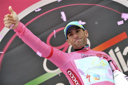 Italy's Vincenzo Nibali celebrates retaining the pink jersey of leader of the race after the 14th stage of the Giro d'Italia, Tour of Italy cycling race, from Cervere to Bardonecchia, Saturday, May 18
