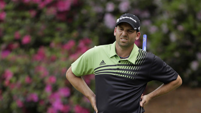 Sergio Garcia, of Spain, reacts to a missed putt on the 13th green during the first round of the Masters golf tournament Thursday, April 11, 2013, in Augusta, Ga. (AP Photo/Charlie Riedel)