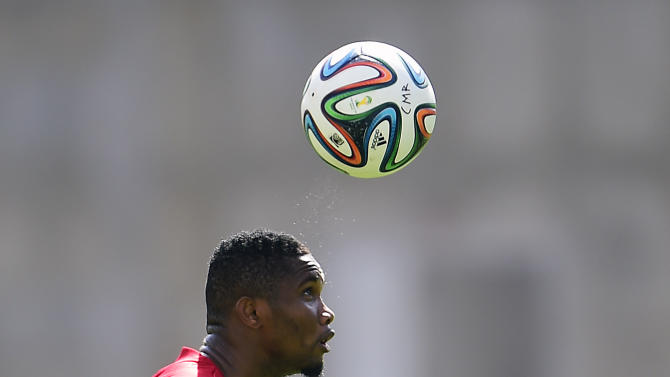 Cameroon forward Samuel Eto'o heads the ball during a World Cup training session at the Kleber Andrade stadium in Vitoria, Brazil on June 10, 2014