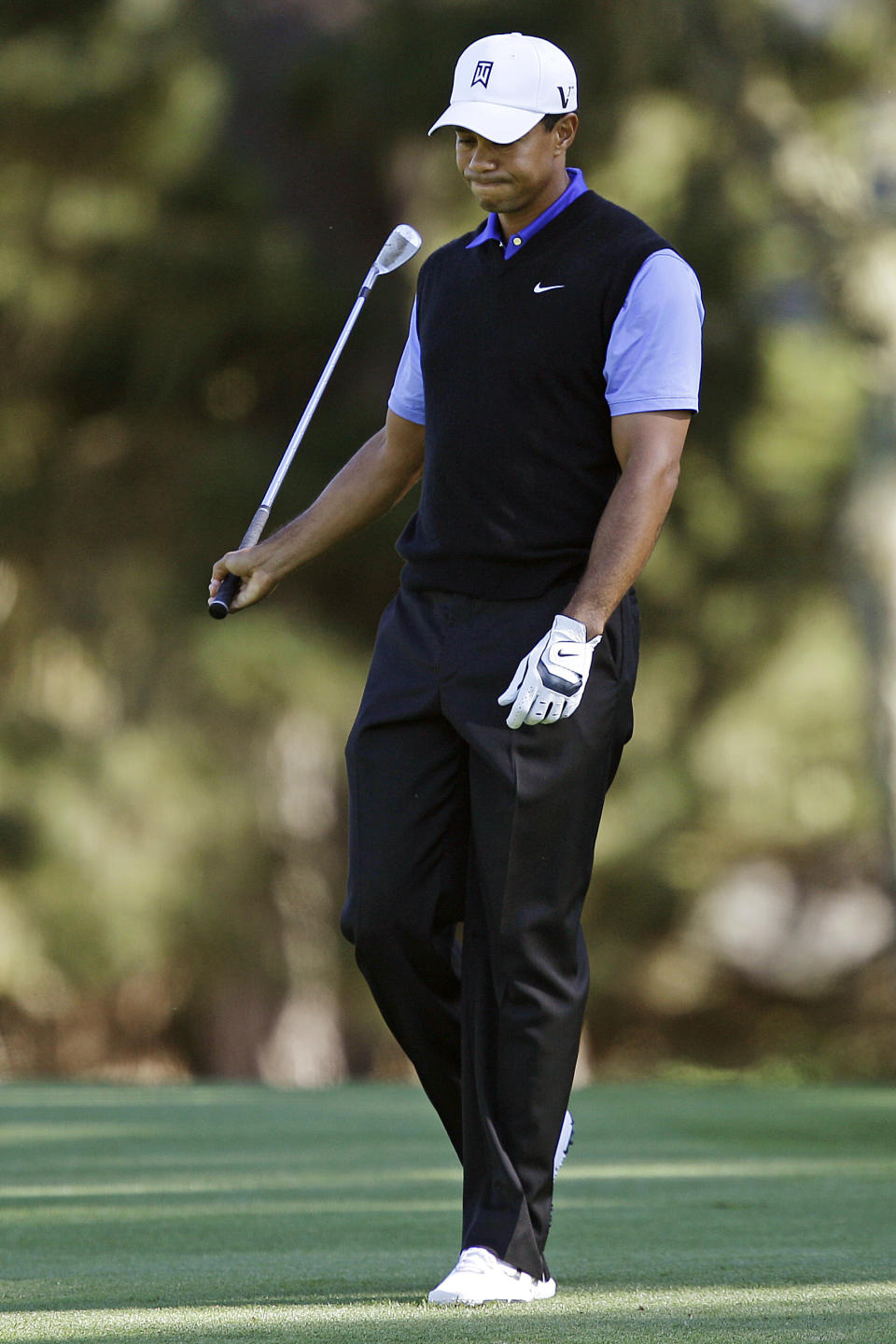 Tiger Woods reacts after hitting from the 18th fairway at Spyglass Hill Golf Course during the first round of the Pebble Beach National Pro-Am golf tournament in Pebble Beach, Calif., Thursday, Feb. 9, 2012. (AP Photo/Marcio Jose Sanchez)