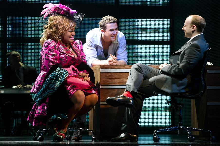 "In this theater image released by The Hartman Group, Da'Vine Joy Randolph, left, Richard Fleeshman, center, and Jeremy Davis are shown in a scene from ""Ghost The Musical,"" at the at the Lunt-Fontanne Theatre in New York. (AP Photo/The Hartman Group, Joan Marcus)"