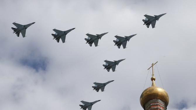 Russian military jets fly in formation during rehearsals for the Victory Day military parade in central Moscow