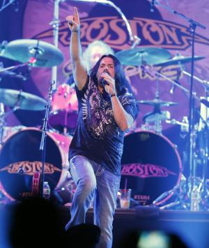 Tommy DeCarlo, lead singer of the group Boston, performs at the Boston Strong Concert: An Evening of Support and Celebration at the TD Garden on Thursday, May 30, 2013 in Boston. (Photo by Bizuayehu Tesfaye/Invision/AP)