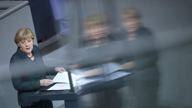 German Chancellor Merkel holds a speech during a debate at the lower house of parliament Bundestag in Berlin