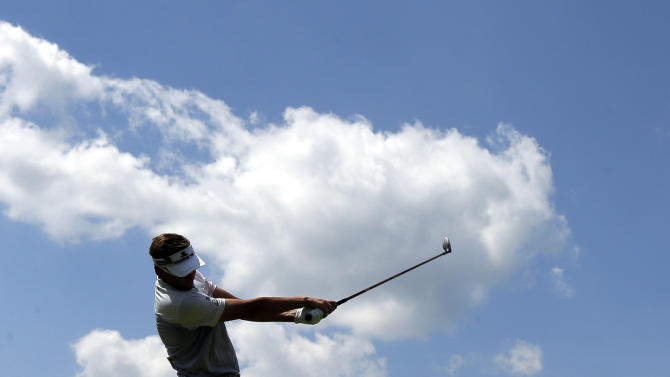 Ian Poulter, of England, tees off on the fourth hole during the third round of the U.S. Open golf tournament at Merion Golf Club, Saturday, June 15, 2013, in Ardmore, Pa. (AP Photo/Charlie Riedel)