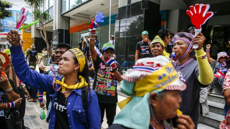 Anti-government protesters gather during a rally at the Shinawatra building in central Bangkok