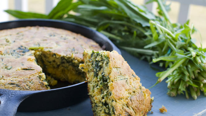 In this undated image, a cumin-dandelion green cornbread is shown in Concord, N.H. (AP Photo/Matthew Mead)