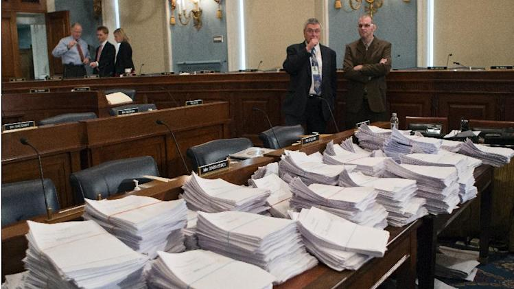 FILE - This May 15, 2013 file photo shows stacks of paperwork awaiting members of the House Agriculture Committee on Capitol Hill in Washington, as it meets to consider proposals to the 2013 Farm Bill. The House's broad rejection on June 19, 2013, of a massive farm bill could signal a shift in the way Congress views agriculture policy. Farm issues once had enormous clout on Capitol Hill, but the healthy agriculture economy and an increased interest in cutting spending have worked against farm-state lawmakers who are trying to push a farm bill through for a third year in a row.  (AP Photo/J. Scott Applewhite, File)