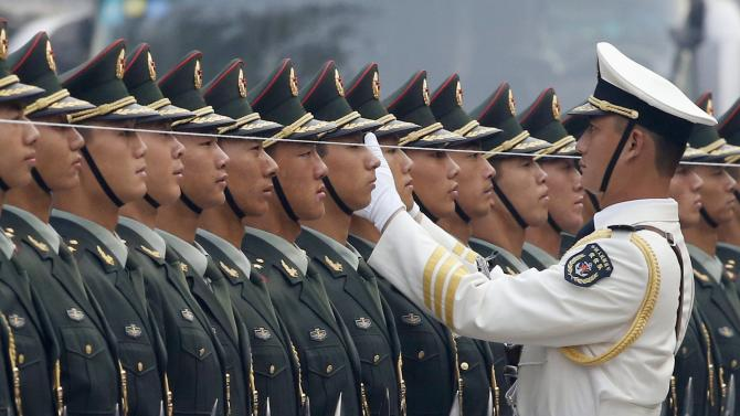 File photo of a PLA officer using string to ensure that soldiers making up guard of honour, stand in straight line before official welcoming ceremony for Afghan President Karzai in Beijing