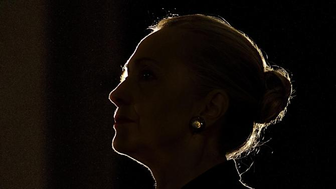Silhouetted by a stage light, Secretary of State Hillary Rodham Clinton speaks at the University of the Western Cape about U.S.-South Africa partnership, Wednesday, Aug. 8, 2012, in Cape Town, South Africa. (AP Photo/Jacquelyn Martin, Pool)