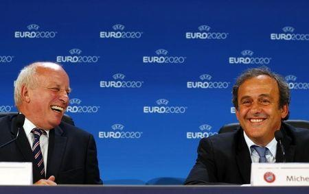 UEFA President Platini and British Football Association chairman Dyke attend a press conference after the announcement of the 13 cities which will host matches at the Euro 2020 tournament during a ceremony in Geneva