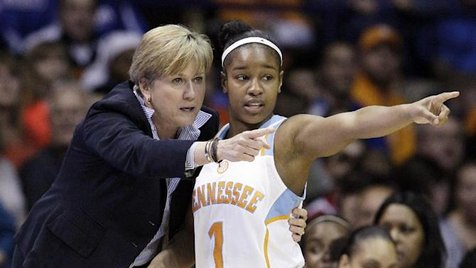 """FILE - In this March 19, 2012, file photo, Tennessee associate head coach Holly Warlick, left, talks with guard Briana Bass (1) during the first half of an NCAA tournament second-round women's college basketball game against DePaul in Rosemont, Ill. Pat Summitt, the sport's winningest coach, is stepping aside as Tennessee's women's basketball coach and taking the title of """"head coach emeritus"""", the university announced, Wednesday, April 18, 2012. Long-time assistant Holly Warlick has been named as Summitt's successor.  (AP Photo/Nam Y. Huh, File)"""