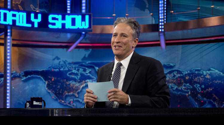 "FILE - This Oct. 18, 2012 file photo shows host Jon Stewart during a taping of ""The Daily Show with John Stewart"", in New York.  Comedy Central says Jon Stewart will take a break from ""The Daily Show"" starting in June to direct and produce his first feature film. The network said Tuesday, March 5, 2013 that correspondent-writer John Oliver will host the fake news show for the eight weeks of original episodes scheduled during Stewart's hiatus. The British-born Oliver has been a ""Daily Show"" regular since 2006. (AP Photo/Carolyn Kaster, file)"