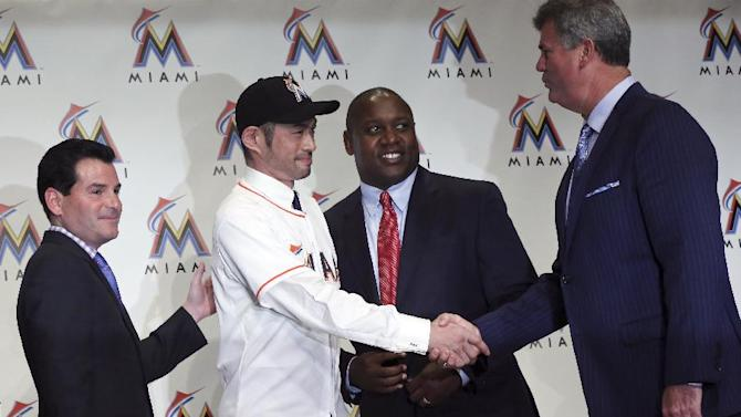Ichiro Suzuki, second left, shake hands with Dan Jennings, right, Miami Marlins team's general manager, as Michael Hill, second right, president of Marlins' baseball operations, and Marlins president David Samson, left, accompany during a news conference in Tokyo, Thursday, Jan. 29, 2015. Ichiro passed his physical and finalized a $2 million, one-year contract with the Miami Marlins. The Marlins made the announcement Tuesday night. His deal includes $2.8 million in performance bonuses based on plate appearances: $400,000 apiece for 300 and each additional 50 through 600
