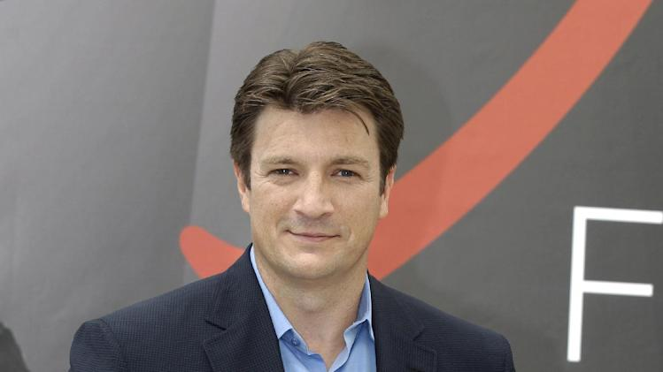 "FILE - In this June 13, 2012 file photo, Canadian actor Nathan Fillion poses during a photocall at the 2012 Monte Carlo Television Festival, in Monaco. Fillion starred in the series ""Firefly,"" which is marking the 10th anniversary of its brief TV run with ""Firefly: Browncoats Unite,"" a special airing 10 p.m. EST Sunday, Nov. 11, on the Science Channel. (AP Photo/Lionel Cironneau, File)"