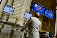 A trader looks an index billboard at Madrid&#39;s stock exchange. A full-blown bailout for Spain, the fourth-largest economy in the eurozone, would dwarf the rescues of Ireland, Greece and Portugal and strain the resources of the EU bloc to the limit