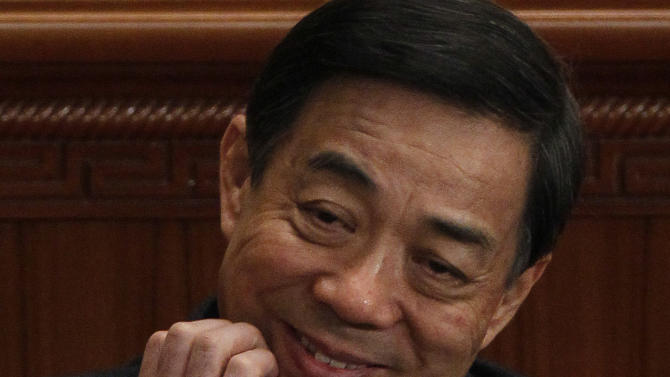 In this photo taken Monday, March 5, 2012, then Chongqing Communist Party Secretary Bo Xilai scratches his chin during the opening session of the National People's Congress in Beijing. As the U.S. presidential race gets ever more bruising, a very different political transition is unfolding in China, one in which the future leaders are trying not to generate news or criticism of the incumbents. The flamboyant Bo is one of the few Chinese politicians who did overtly campaign for a higher-level job, and that is believed to be one of the sins that led to his downfall. (AP Photo/Ng Han Guan)