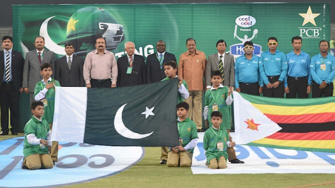 Pakistan's President Mamnoon Hussain (C) stands along with Zimbabwe's and Pakistani cricket officials at the opening ceremony of the first International T20 cricket match at the Gaddafi Cricket Stadium in Lahore on May 22, 2015