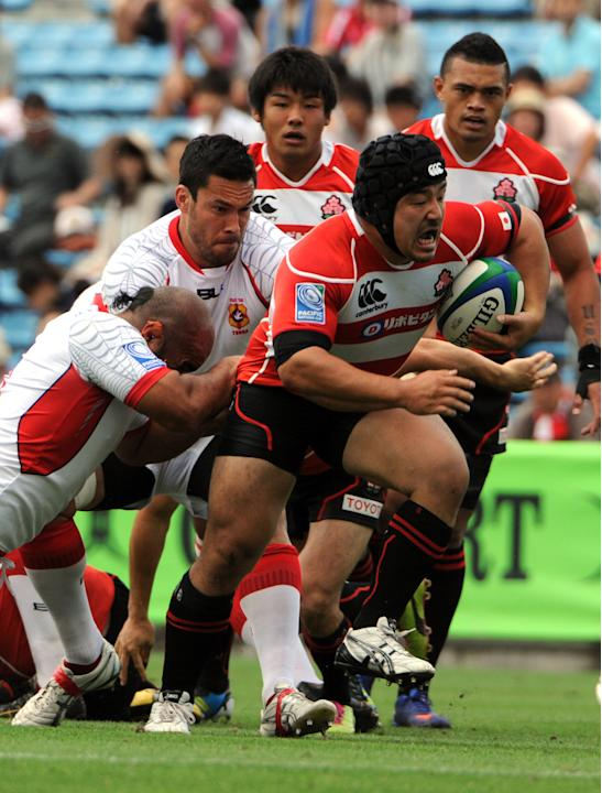 Japan's Yusuke Nagae drags Tonga's playe