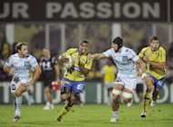 Clermont's French centre Wesley Fofana (2nd L) tries to escape a tackle during the French Top 14 rugby Union match ASM Clermont Auvergne vs Racing Paris 92, at the stadium Marcel Michelin in the French central city of Clermont-Ferrand. Clermont stretched their unbeaten home record to 45 matches with a hard-fought 13-12 victory over Racing-Metro in the Top 14 on Sunday