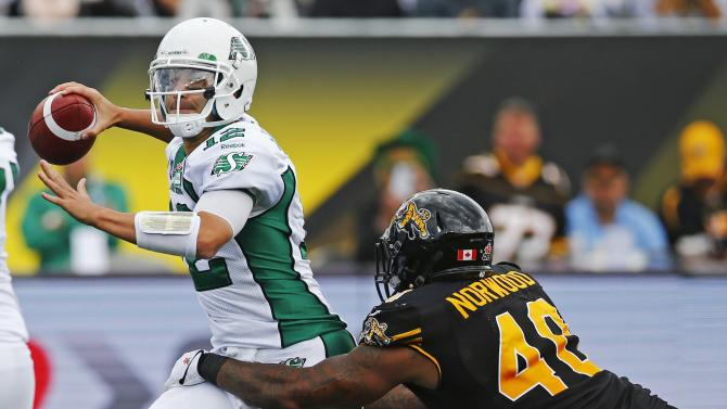 Saskatchewan Roughriders' quarterback Sunseri is sacked by Hamilton Tiger-Cats' Norwood during the second half of their CFL football game in Hamilton