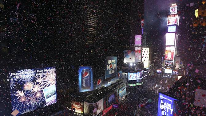 Confetti flies over New York's Times Square after the clock strikes midnight during the New Year's Eve celebration as seen from the Marriott Marquis hotel Tuesday, Jan. 1, 2013 in New York.  (AP Photo/Mary Altaffer)