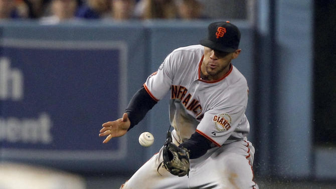 San Francisco Giants left fielder Mark DeRosa cannot get to a hit for a single by Los Angeles Dodgers' Dee Gordon, not pictured, during the seventh inning of a baseball game in Los Angeles, Tuesday, Sept. 20, 2011. (AP Photo/Alex Gallardo)