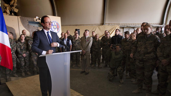 French President Francois Hollande prepares to deliver his speech after visiting troops at Forward Operating Base (FOB) in Nijrab, Kapisa region of Afghanistan Friday, May 25, 2012, where most of French troops are stationed in Afghanistan. France's new President Francois Hollande arrived early Friday in Afghanistan to meet with troops and the country's president and discuss plans for an early pullout. (AP Photo/Joel Saget, Pool)