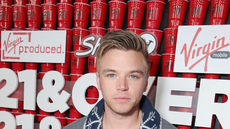 "Brett Davern arrives at the LA premiere of ""21 and Over"" at the Westwood Village Theatre on Thursday, Feb. 21, 2013 in Los Angeles. (Photo by Eric Charbonneau/Invision/AP)"
