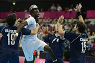 France&#39;s rightwing Luc Abalo (2ndL) jumps to shoot during the men&#39;s preliminaries Group B handball match Argentina vs France for the London 2012 Olympics Games on July 31, 2012 at the Copper Box hall in London.     AFP PHOTO/ JAVIER SORIANO