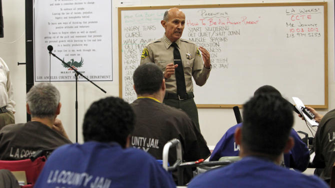 Los Angeles County Sheriff Lee Baca, who is supervises the largest jail system in the nation, visits a Merit class at the Men's Central Jail in downtown Los Angeles Wednesday, Oct. 3, 2012. Baca says he plans to implement all the reforms suggested by a commission in the wake of allegations that a culture of violence flourished in his jails. (AP Photo/Reed Saxon)