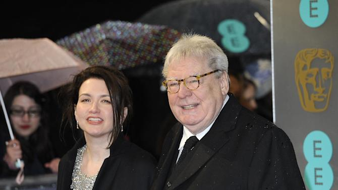 "Lisa Parker, left, and director Alan Parker arrive for the BAFTA Film Awards at the Royal Opera House on Sunday, Feb. 10, 2013, in London. Alan Parker, who has directed films including ""Evita,""  ""Bugsy Malone"" and ""Mississippi Burning,"" will be honored with the Bafta Fellowship award. (Photo by Jonathan Short/Invision/AP)"