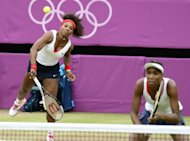 Venus Williams (right) and Serena Williams play against Czech Republic's Andrea Hlavackova and Lucie Hradecka during the women's doubles gold medal match. Venus and Serena joined Spain's Conchita Martinez, who won silver in 1992 and 2004 and bronze in 1996, as the only tennis players to win medals at three different Olympics