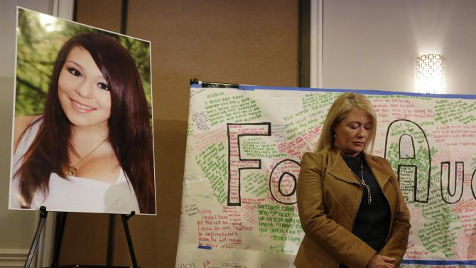 Sheila Pott, mother of Audrie Pott who committed suicide after a sexual assault, stands by a photograph of her daughter and message board during a news conference Monday, April 15, 2013 in San Jose, Calif. The family of a girl who committed suicide after she was sexually assaulted and a photo of the act was shared in text messages said Monday the three 16-year-old boys responsible were sober when the assault happened.   (AP Photo/Eric Risberg)